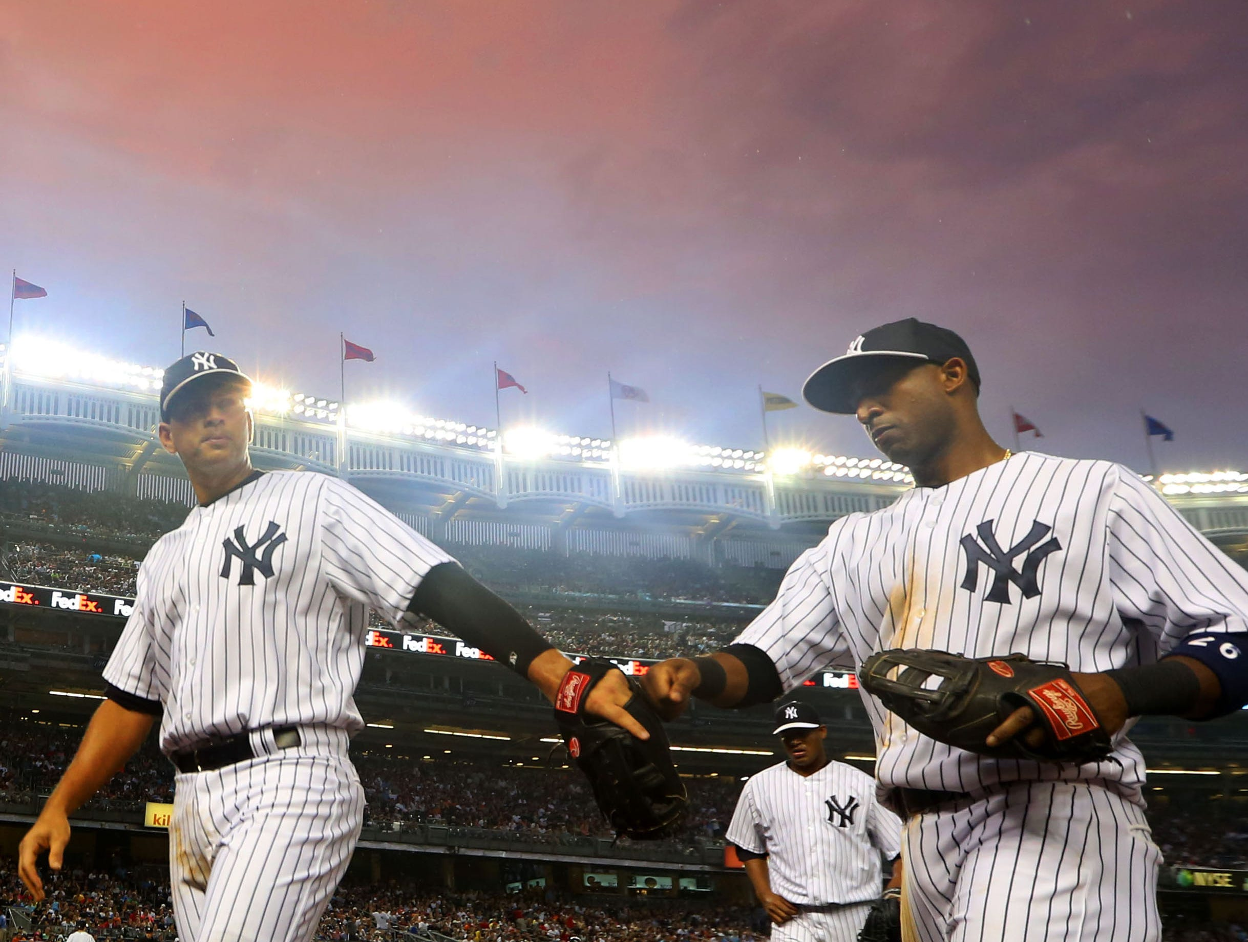 Alex Rodriguez, left, and shortstop Eduardo Nunez walk off the field after the bottom of the  first inning against the Detroit Tigers at Yankee Stadium.