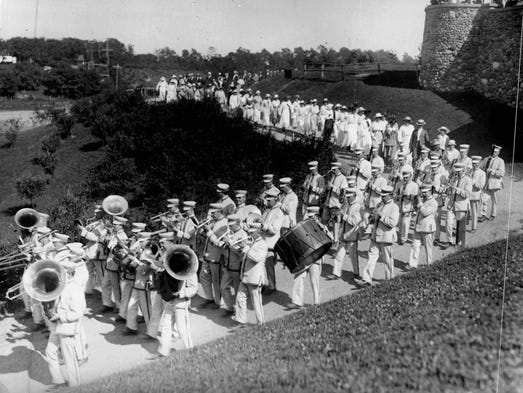 Led by the white and gold uniformed Park Band, a group