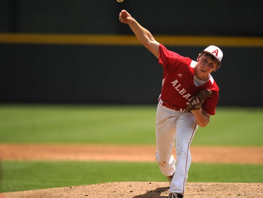 Albany pitcher Brian Hamilton (4) throws a pitch during