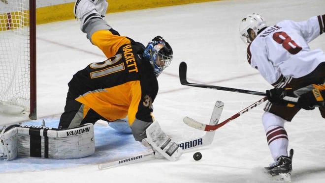 Buffalo Sabres goaltender Matt Hackett (31) makes a save on Arizona Coyotes right wing Tobias Rieder Thursday night in Buffalo.