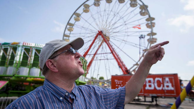 James Borwey, manager of elevator, boiler and amusement ride bureau with the Iowa Division of Labor, inspects rides at the Iowa State Fair Wednesday Aug. 10, 2016.
