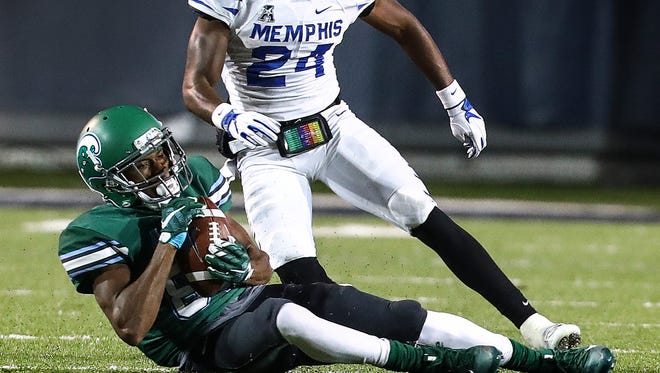Tulane University receiver Darnell Mooney (bottom) grabs a first down catch in front of  University of Memphis Tulane University defenderTito Windham (top) during fourth quarter action in Memphis, Tenn., Friday, October 27, 2017.