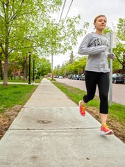 Paige Radney runs on South Williams Street, in preparation
