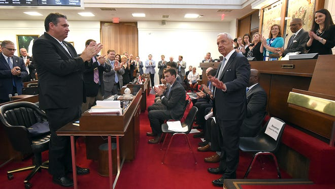 University of North Carolina basketball coach Roy Williams acknowledges a standing ovation during a joint session of the state House and Senate May 3 held to honor his team's national championship.