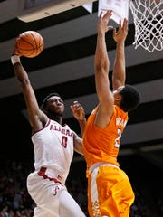 Alabama forward Donta Hall scores against Tennessee