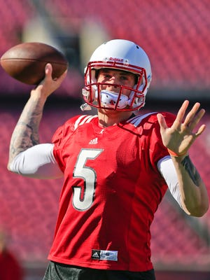 Louisville QB Tyler Ferguson warms up from the sidelines Saturday during the Spring scrimmage. By Matt Stone, The C-J April 11, 2015.