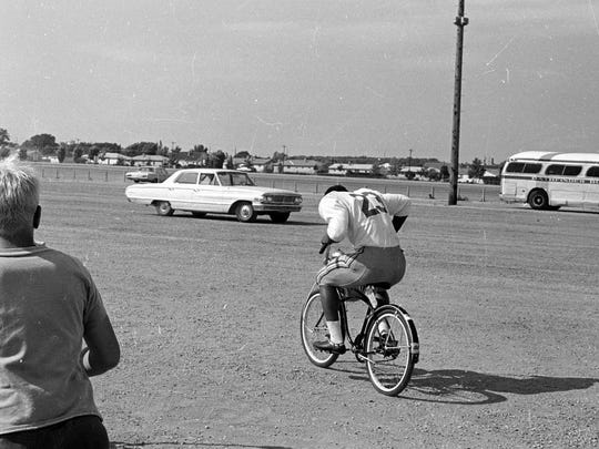 Green Bay Packers running back Travis Williams rides a bike from the practice field to the locker room at Lambeau Field during training camp in late July 1969.