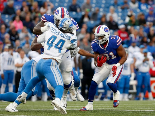 Detroit Lions linebacker Jalen Reeves-Maybin (44) gets blocked as Buffalo Bills running back Jonathan Williams (31) runs the ball during the first quarter at New Era Field.