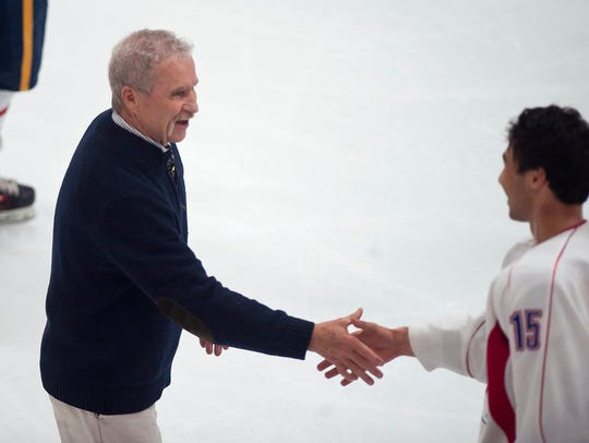 Vermont coach Bill O'Neil, left, shakes hands with