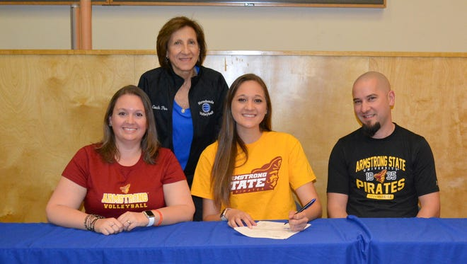 Horseheads senior Emily Crowell, center, signed Wednesday to play Division I volleyball at Armstrong State University. Next to her are her parents, Sean and Jennifer Crowell. In the background is Horseheads head coach Patti Perone.