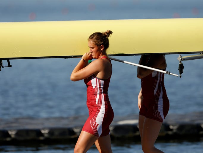 Indiana University rowing team member Hanna Henry helps unload the boat after competing in the NCAA Rowing Championships at Eagle Creek Park Sunday June 1, 2014.