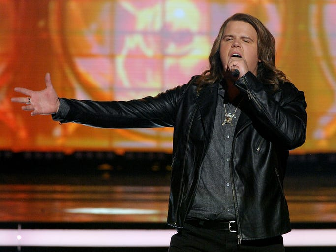 """Finalist Caleb Johnson performs onstage during Fox's """"American Idol"""" XIII Finale at Nokia Theatre L.A. Live on May 21, 2014, in Los Angeles."""