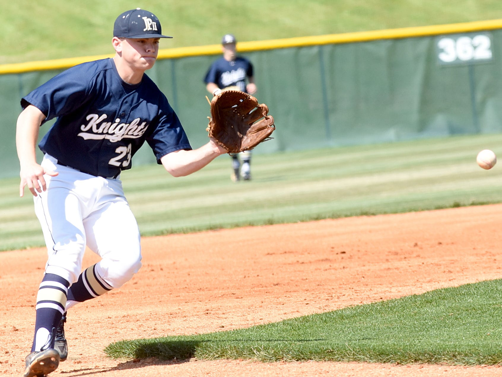 Pope John Paul II High senior third baseman Garrett Taylor fields a first-inning ground ball. Taylor tripled, singled, scored a run and drove in a run in Thursday afternoon's 5-0 victory.