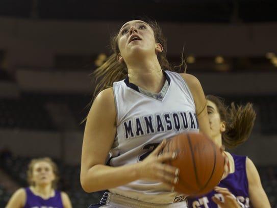 Marina Mabrey grabs her own rebound and prepares to