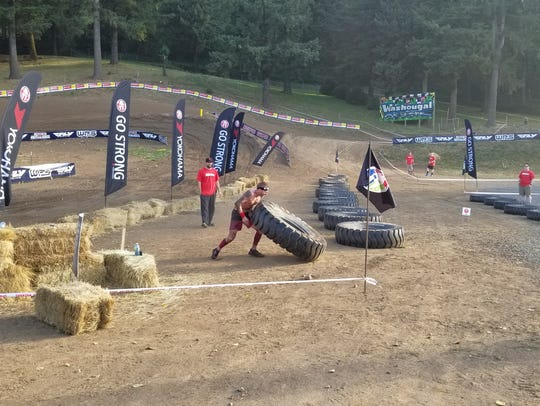 Jeff Huxhold competes in a Spartan race earlier this