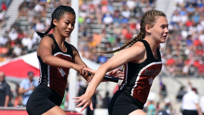 Ridgewood's Grace Gottshall, left, hands off to teammate Raquel Foster during the 4x100 relay at the Division III state track and field meet on Saturday at Ohio State's Jesse Owens Memorial Stadium. The Generals placed third overall in :50.21.