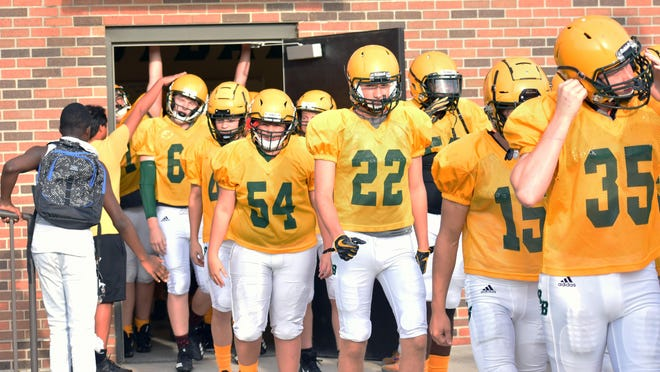 Rock Bridge players walk out of the locker room before a high school football jamboree against Battle, Hickman and Jefferson City last year.