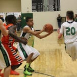 Dee Bowler looks to pass the ball to an open teammate during Thursday's game.
