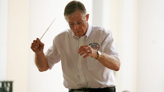 Bob Moody directs the Stonewall Brigade Band, the nation's oldest continuous community band, as they play selections during Mary Baldwin College's Commencement Ceremony on May 17, 2015.