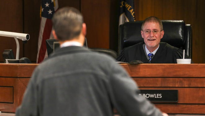 """Judge David Bowles speaks to litigants in a court that handles restraining orders/protective orders for couples who've dated or are not in a """"relationship"""".March 28, 2016"""