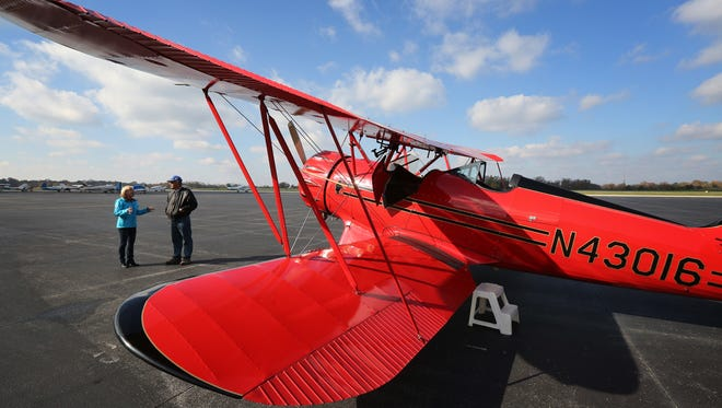 C-J Buzz Columnist Kirby Adams gets a tour of a biplane owned by Steve Koch at Bowman Field. C-J Buzz Columnist Kirby Adams gets a tour of a bi-plane owned by Steve Koch at Bowman Field. November 9, 2015