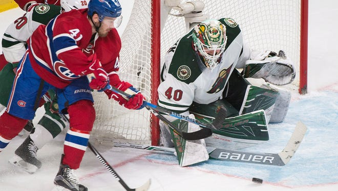 Montreal Canadiens' Paul Byron (41) moves against Minnesota Wild's goaltender Devan Dubnyk as during third-period NHL hockey game action in Montreal, Thursday, Dec. 22, 2016. (Graham Hughes/The Canadian Press via AP)