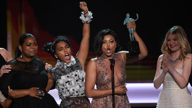 """From left, Octavia Spencer, Janelle Monae, Taraji P. Henson and Kirsten Dunst accept the award for outstanding performance by a cast in a motion picture for """"Hidden Figures"""" at Sunday's 23rd annual Screen Actors Guild Awards."""