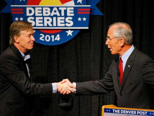 Democratic Gov. John Hickenlooper, left, and Republican
