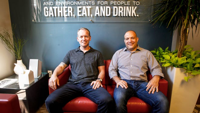 Four Entertainment Group owners Dan Cronican and Bob Deck pose for a portrait Monday, June 12, 2017, in their offices in Over-the-Rine.