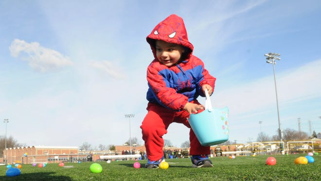 A 4-year-old collects eggs at the Belleville Municipal Stadium on Saturday, March 19, 2016. This year's annual Egg Hunt will be held Saturday, April 15 at the Municipal Stadium at Belleville High School at 9 a.m.