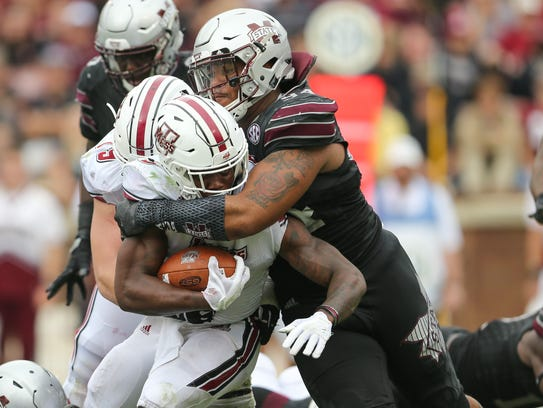 Mississippi State's Jeffery Simmons (94) wraps up UMass's