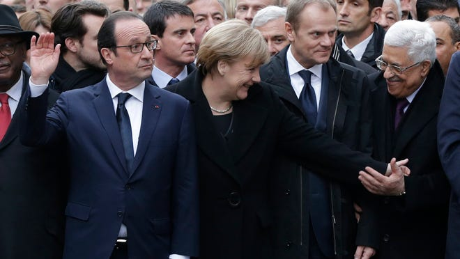French President Francois Hollande leads a group of international leaders at rally in Paris on Jan. 11.