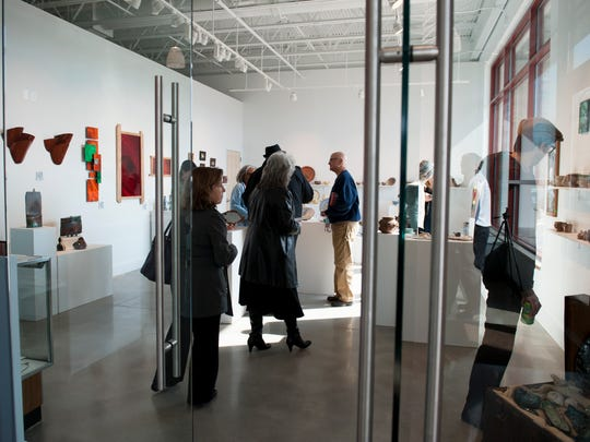 Visitors tour the student gallery in the Cumberland