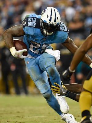 Titans running back DeMarco Murray (29) picks up some yards in the third quarter against the Jaguars at Nissan Stadium Thursday, Oct. 27, 2016, in Nashville, Tenn.