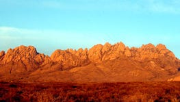 The Organ Mountains glow in a red-orange hue in February 2009.