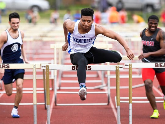 Memorial's Stacen Cunningham clears the final hurdle in winning the boys' 110 high hurdles in 15.60 at the City meet. He also placed first in the 300 lows.