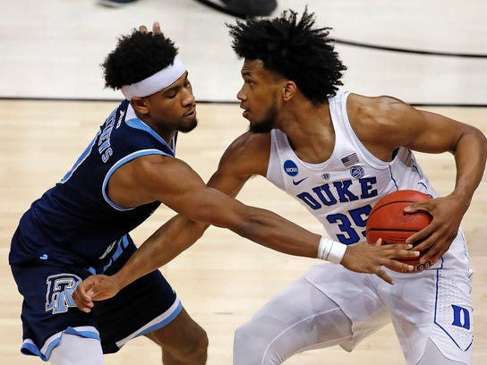 Duke's Marvin Bagley III (35) is defended by Rhode Island's E.C. Matthews during the second half of an NCAA men's college basketball tournament second-round game, in Pittsburgh, Saturday, March 17, 2018. Duke won 87-62. (AP Photo/Gene J. Puskar)