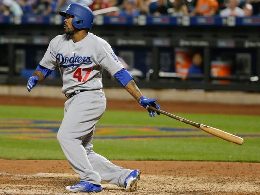 Los Angeles Dodgers' Howie Kendrick (47) follows through on a home run during the eighth inning of a baseball game against the New York Mets, Saturday, May 28, 2016, in New York. (AP Photo/Frank Franklin II)