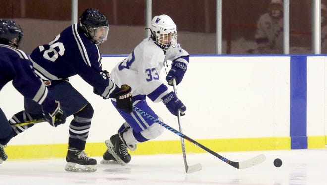 Westfield's Trevor Tanella (33) battles for control of the puck during the first period on Wednesday at Warinanco Park.