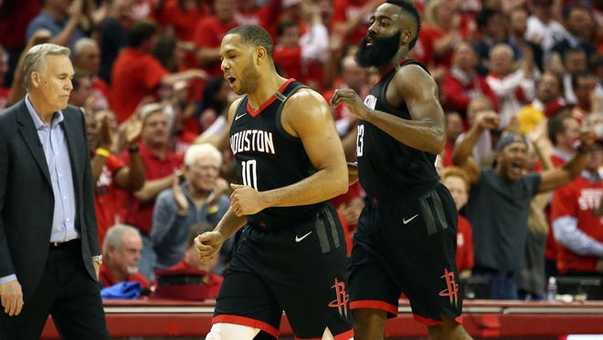 Houston Rockets guard Eric Gordon (10) and guard James Harden (13) react during the fourth quarter in game five of the Western conference finals of the 2018 NBA Playoffs against the Golden State Warriors at Toyota Center.