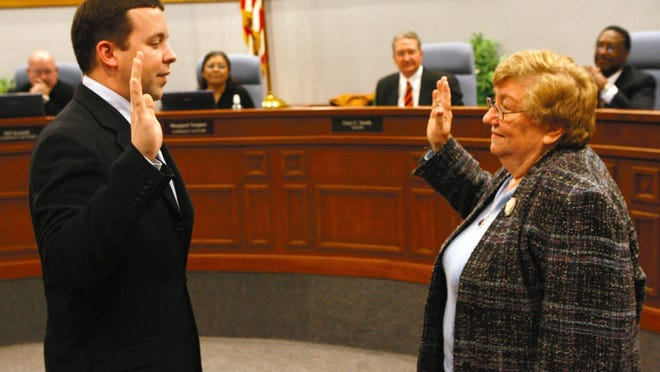 FILE: Dane Bragg, left, is sworn in by City Clerk Anita Carlton as the new Galesburg city manager in January 2007. Carlton, Galesburg City Clerk from 1983-2009, died in 2020.
