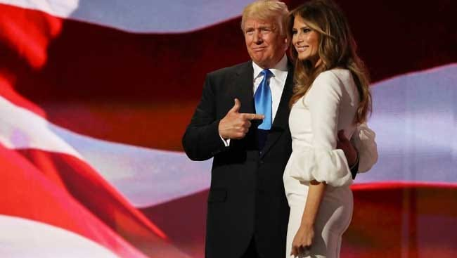 Donald Trump poses with his wife, Melania, after her speech at the Republican National Convention on Monday in Cleveland.