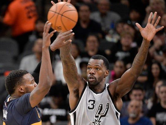 San Antonio Spurs center Dewayne Dedmon, shown guarding