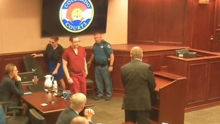 James Holmes walks to the lectern to hear Judge Carlos Samour formally sentence him to life in prison.
