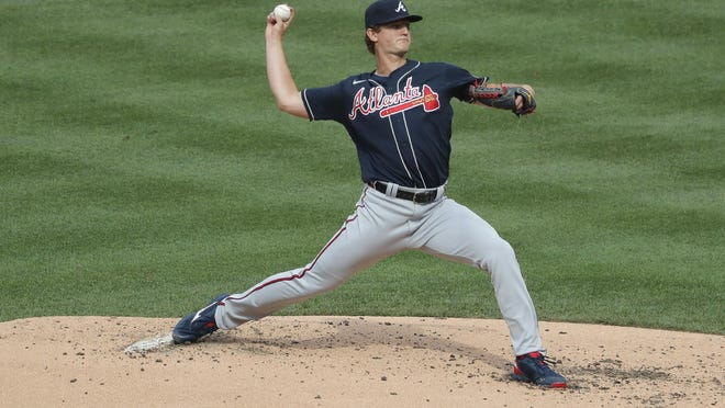 Atlanta Braves starting pitcher Mike Soroka throws during the second inning of the  game against the New York Mets at Citi Field on Friday in New York. The Mets won 1-0, spoiling an outstanding outing for Soroka. The teams' game Saturday was not over at press time.
