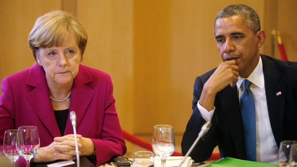 AP_BELGIUM_US_OBAMA_MERKEL_GERMANY_64721402