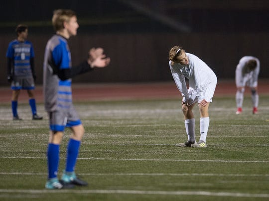 Jake Rademacher of Fort Collins High School reacts after a missed opportunity for a Lambkins goal during the CHSAA State Soccer Semifinals at Echo Park Stadium in Parker on Wednesday, November 8, 2017.