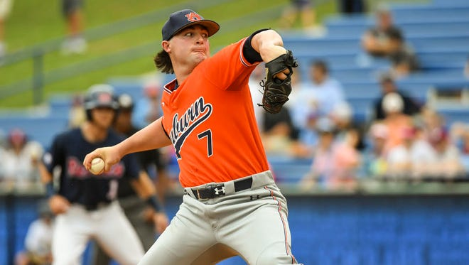 Auburn freshman pitcher Tanner Burns picks up the win in his Southeastern Conference Tournament debut vs. Ole Miss in a 9-3 win Wednesday.