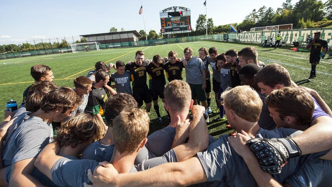Vermont huddles together before the start of the men's soccer game against the UNC-Asheville Bulldogs at Virtue Field on Sept. 11, 2015.