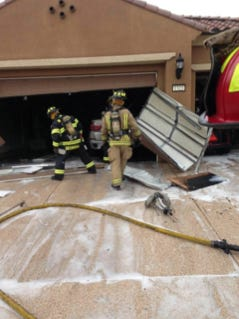 Mesquite firefighters work to extinguish a garage fire Wednesday afternoon.